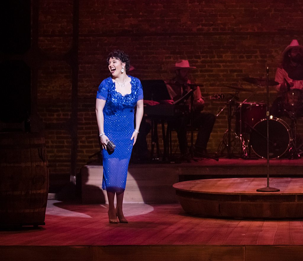 Annie Tracy Marsh as Patsy Cline singing on stage