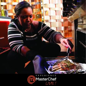 Chef Kimberly checking the temperature on a rack of lamb