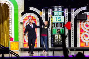 Host of The Price is Right Live! and contestant cheer
